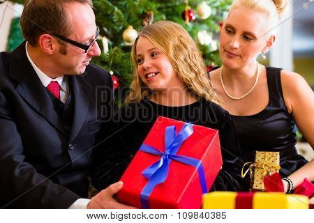 Parents and daughter with Christmas gifts on boxing day