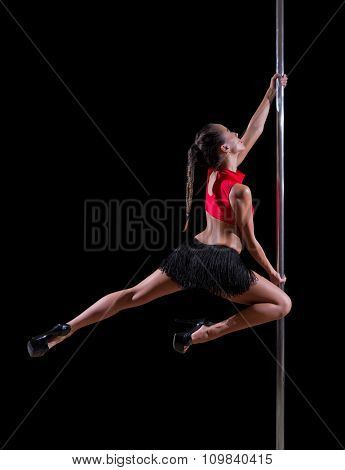 Pole dancer isolated on black