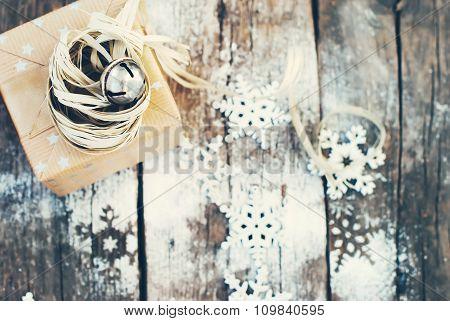 Jingle Hand Bell And Natural Twine As Decor On Christmas Box