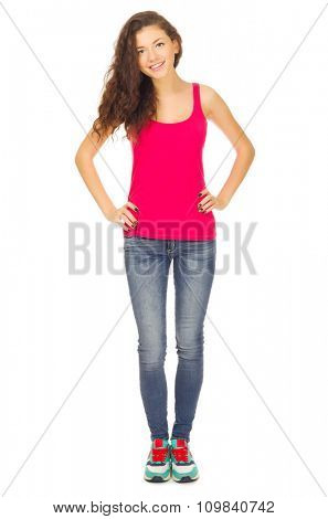 Young sporty girl in blue jeans isolated