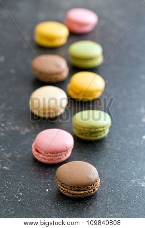 colorful french macarons on old table