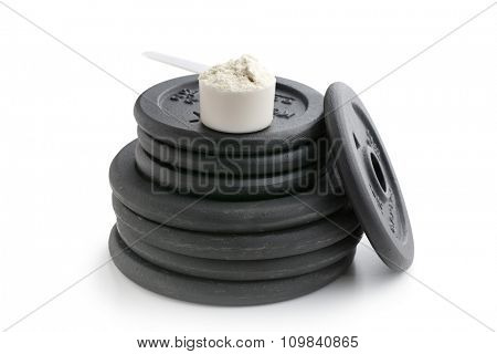 Dumbbell weight and whey protei on white background