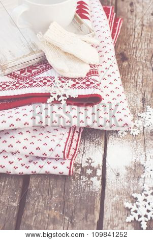 Mittens, Snowflakes And Blanket On Wooden Table
