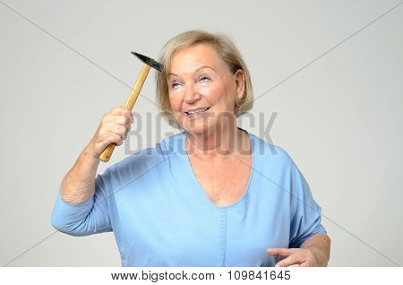 Elderly Lady Hitting Her Head With A Hammer