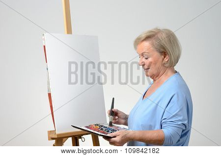Senior Woman Enjoying Herself Painting