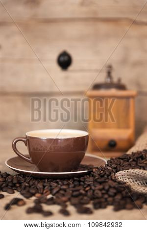 Coffee Beans, A Cup And A Coffee Grinder