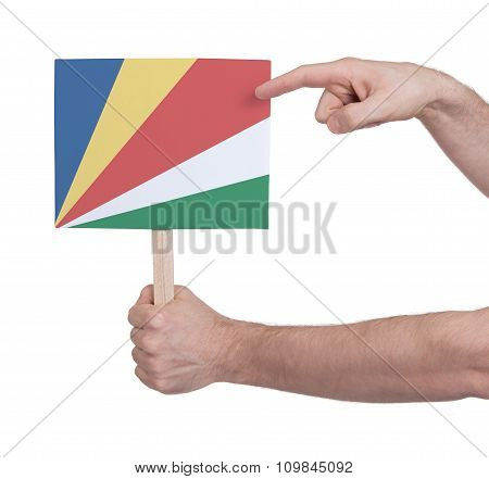 Hand Holding Small Card - Flag Of Seychelles