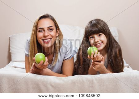 Healthy snack for mother and daughter
