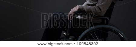 Person Sitting On A Wheelchair