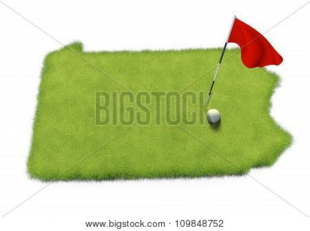 Golf ball and flag pole on course putting green shaped like the state of Pennsylvania
