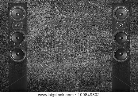 black music speakers on gray wall background