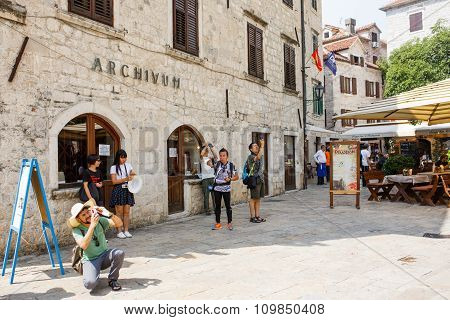 Kotor, Montenegro - August 10, 2015: Tourists Walk Ans Taking Pictures In Kotor Old Town In  Montene