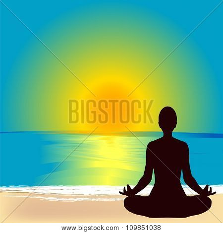 Silhouette Of Woman Practicing Yoga On The Beach At Sunrise