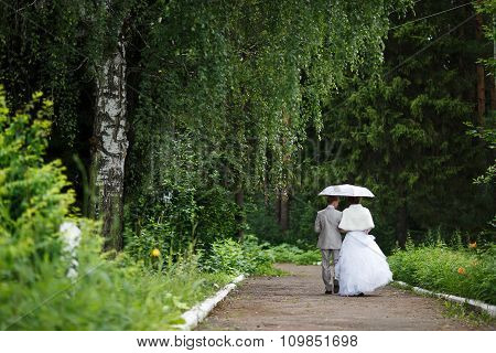 Beautiful Just Married Couple Under Umbrella
