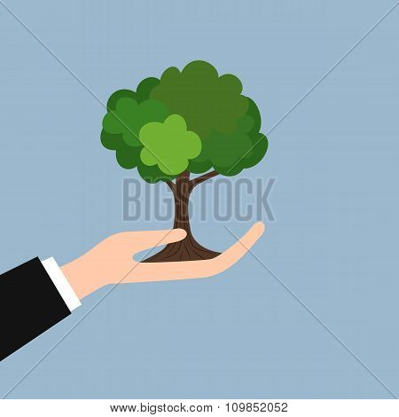 Green tree in hand
