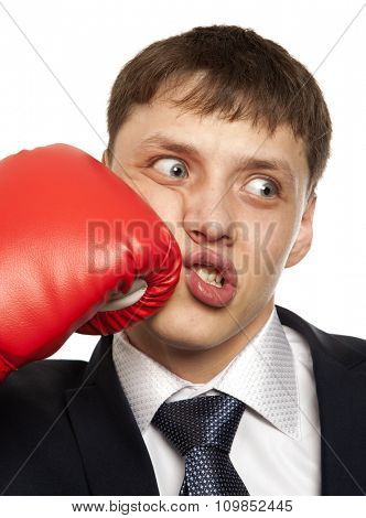 Businessman in red boxing gloves isolated on white background