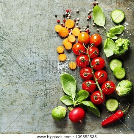 Fresh organic vegetables on rustic background. Healthy food. Vegetarian eating. Fresh harvest from the garden. Background layout with free text space.