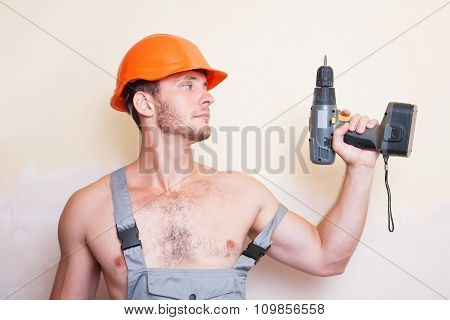 Man In Overalls With A Screwdriver