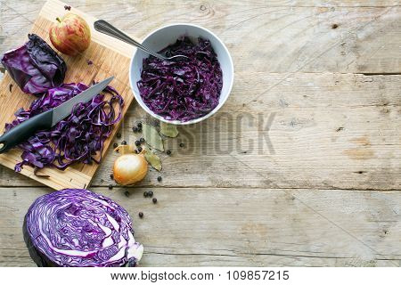 Preparing Red Cabbage For A Festive Dinner On A Rustic Wooden Table, View From Above, Copy Space