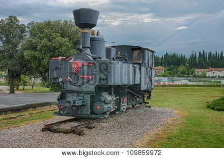 Old Steam Locomotive At Train Station On Cloudy Day