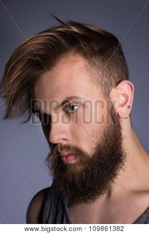 Brutal bearded man. Brutal bearded man wearing t-shirt.