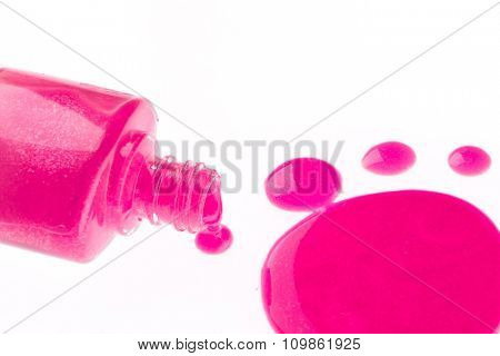 spilled nail polish on white background