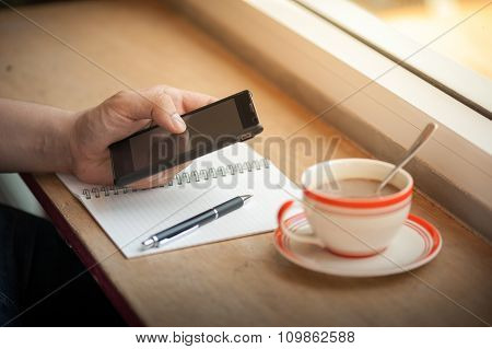 Using Smart Phone With Coffee Cup