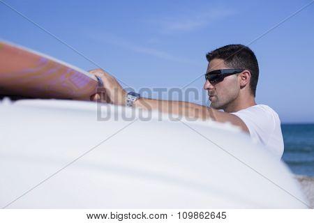 Man Surfer Taking Surf Board.