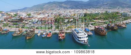 ALANIA - AUG 16, 2015: City panorama with Alania Sea Port at summer sunny day. Aerial view videoframe