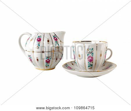 Porcelain Gravy Boat, teacup and saucer with ornament of roses in retro style isolated on white.