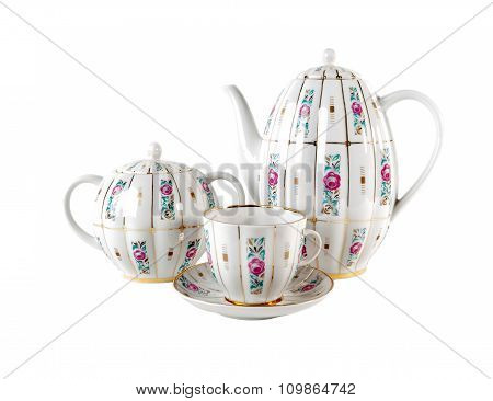 Porcelain teapot, teacup with saucer and sugar-bowl with floral roses ornament in retro style isolat