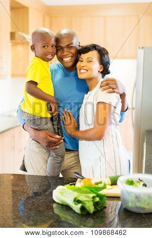 portrait of lovely afro american family in home kitchen