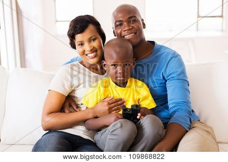 beautiful african couple and son at home
