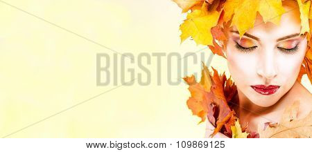 The woman in the image of the autumn
