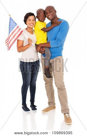 portrait of young american family with usa flag isolated on white