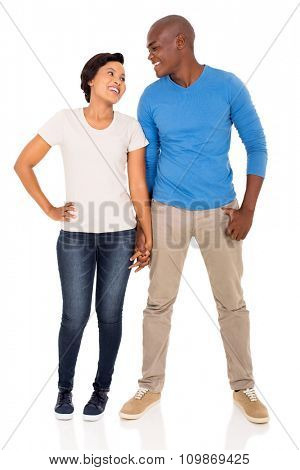 full length portrait of african couple holding hands on white background