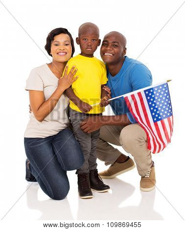 adorable african american family of three with usa flag
