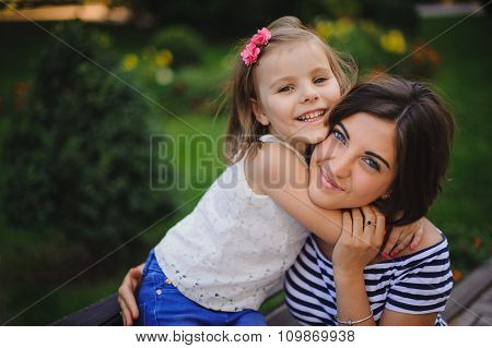 Happy Young Mother With Little Daughter Outdoor
