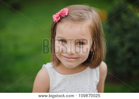 Portrait Of Beautiful Young Girl With Blond Hair