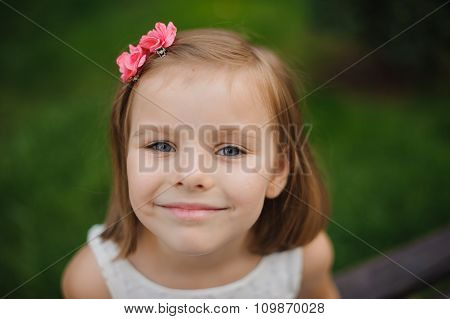 Outdoor Close Up Portrait Of A Cute Young Girl Smiling
