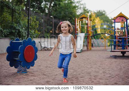 Beautiful Little Girl On Outdoor Playground