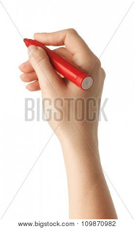 Female hand is ready for drawing with red marker. Isolated on white.