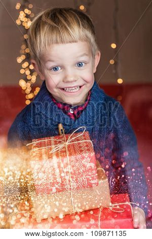 Portrait of a happy little boy holding a new gift. Christmas. Birthday