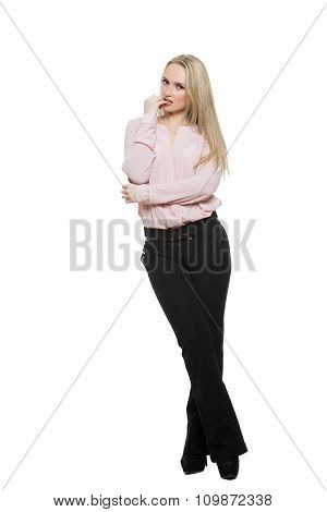 girl in pants and blous.  Isolated on white background. body language. restrained sexuality. finger
