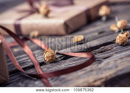 Holiday close-up background with small dried rose flowers and petals