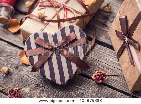 Vintage gift boxes on old wood