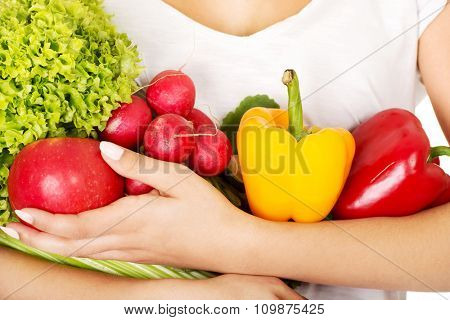 Young woman with healthy vegetables.