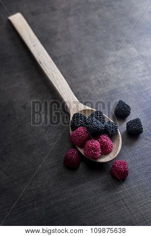 Colorful Jelly Candies In Spoon On Wooden Table