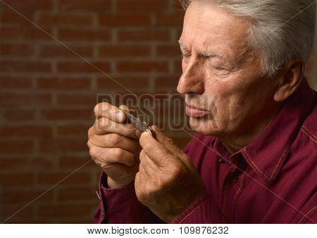 Elderly man treated by medicines