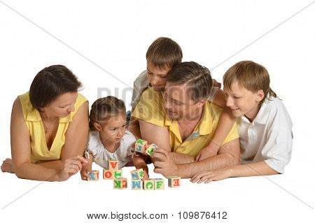 Family playing with cubes